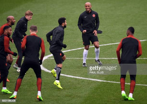 Manchester City's Belgian defender Vincent Kompany takes part in a training session at the City Football Academy in Manchester north west England on...
