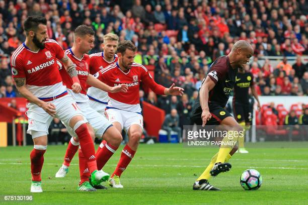 Manchester City's Belgian defender Vincent Kompany turns away from the Middlesborough defence including Middlesbrough's Spanish striker Alvaro...