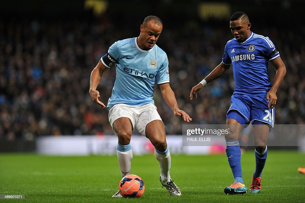 Manchester City's Belgian defender Vincent Kompany vies with Chelsea's Cameroonian striker Samuel Eto'o (R) during the English FA Cup fifth round football match between Manchester City and Chelsea at The Etihad Stadium in Manchester, northwest England on February 15, 2014. AFP PHOTO / PAUL ELLIS USE. No use with unauthorized audio, video, data, fixture lists, club/league logos or live services. Online in-match use limited to 45 images, no video emulation. No use in betting, games or single club/league/player publications.