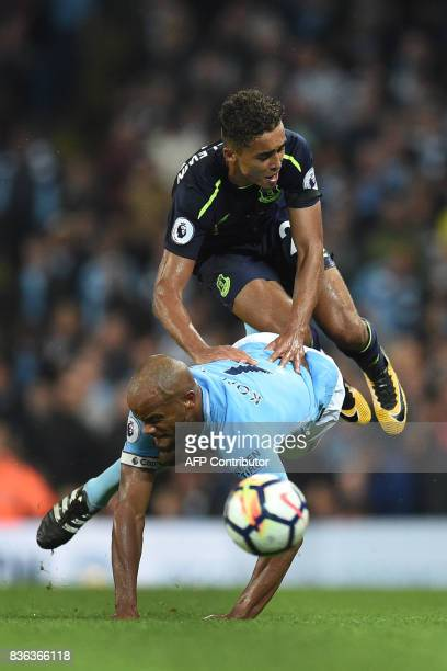 Manchester City's Belgian defender Vincent Kompany vies with Everton's English striker Dominic CalvertLewin during the English Premier League...