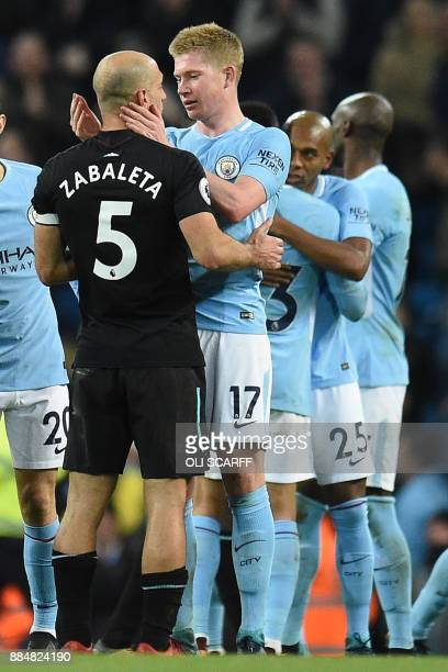 Manchester City's Belgian midfielder Kevin De Bruyne and exteammate West Ham United's Argentinian defender Pablo Zabaleta chat on the pitch after the...