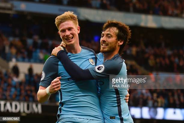 Manchester City's Belgian midfielder Kevin De Bruyne celebrates scoring their second goal with Manchester City's Spanish midfielder David Silva...