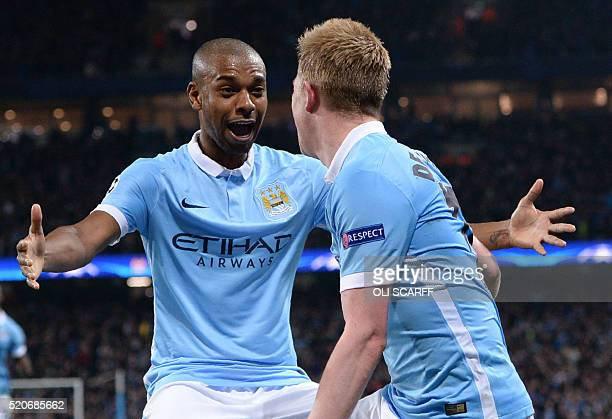 Manchester City's Belgian midfielder Kevin De Bruyne celebrates with Manchester City's Brazilian midfielder Fernandinho after scoring during the UEFA...