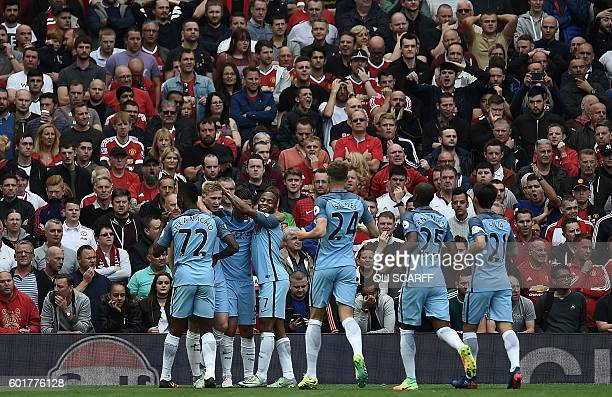 Manchester City's Belgian midfielder Kevin De Bruyne celebrates with teammates after scoring the opening goal in the English Premier League football...