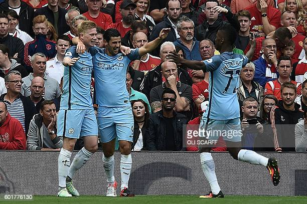 Manchester City's Belgian midfielder Kevin De Bruyne celebrates with Manchester City's Spanish midfielder Nolito and Manchester City's Nigerian...