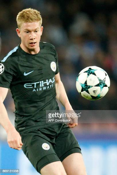 Manchester City's Belgian midfielder Kevin De Bruyne eyes the ball during the UEFA Champions League football match Napoli vs Manchester City on...