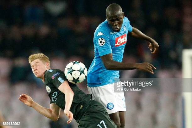 Manchester City's Belgian midfielder Kevin De Bruyne fights for the ball with Napoli's defender from France Kalidou Koulibaly during the UEFA...