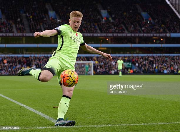 Manchester City's Belgian midfielder Kevin de Bruyne kicks the ball during the English Premier League football match between Aston Villa and...
