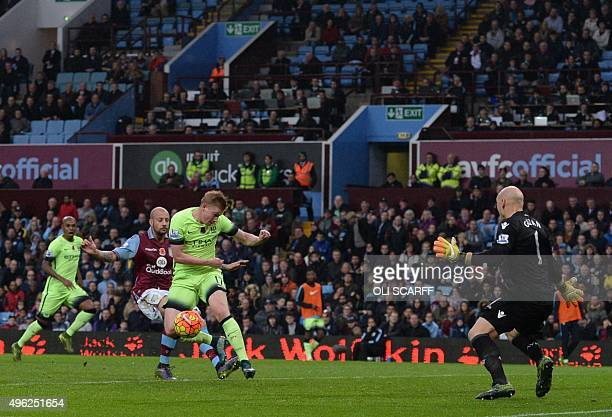 Manchester City's Belgian midfielder Kevin de Bruyne misses a shot on goal by Aston Villa's US goalkeeper Brad Guzan during the English Premier...