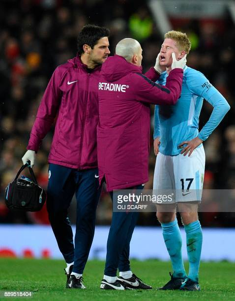 Manchester City's Belgian midfielder Kevin De Bruyne recieves attention during the English Premier League football match between Manchester United...