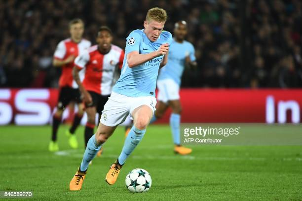 Manchester City's Belgian midfielder Kevin De Bruyne runs with the ball during the UEFA Champions League Group F football match between Feyenoord...