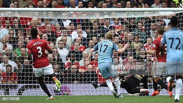 Manchester City's Belgian midfielder Kevin De Bruyne scores the opening goal past Manchester United's Spanish goalkeeper David de Gea during the...