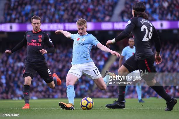 Manchester City's Belgian midfielder Kevin De Bruyne scores the opening goal during the English Premier League football match between Manchester City...