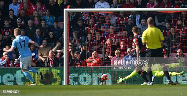 Manchester City's Belgian midfielder Kevin De Bruyne scores their second goal past Bournemouth's Polish goalkeeper Artur Boruc during the English...