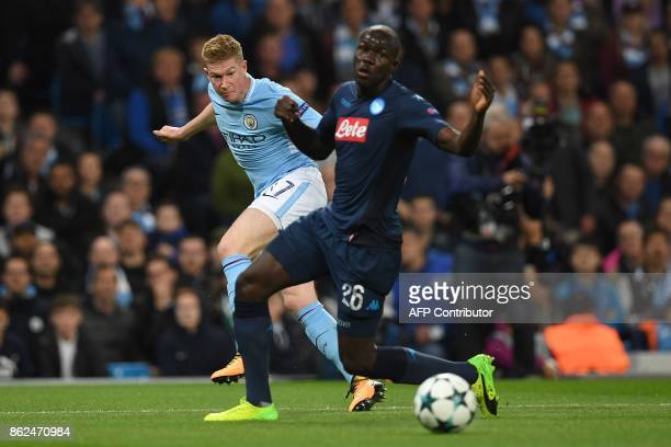 Manchester City's Belgian midfielder Kevin De Bruyne shots past Napoli's Frenchborn Senegalise defender Kalidou Koulibaly during the UEFA Champions...