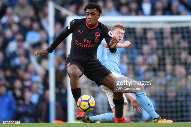 Manchester City's Belgian midfielder Kevin De Bruyne vies with Arsenal's Nigerian striker Alex Iwobi during the English Premier League football match...