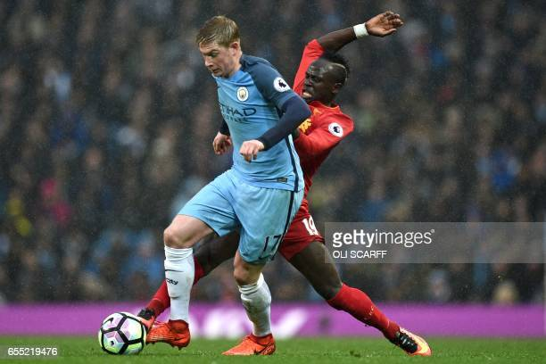 Manchester City's Belgian midfielder Kevin De Bruyne vies with Liverpool's Senegalese midfielder Sadio Mane during the English Premier League...