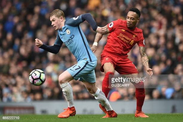 Manchester City's Belgian midfielder Kevin De Bruyne vies with Liverpool's English defender Nathaniel Clyne during the English Premier League...