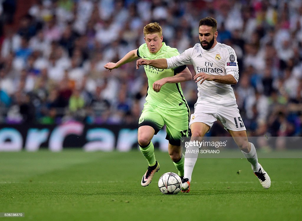 Manchester City's Belgian midfielder Kevin De Bruyne vies with Real Madrid's defender Dani Carvajal (R) during the UEFA Champions League semi-final second leg football match Real Madrid CF vs Manchester City FC at the Santiago Bernabeu stadium in Madrid, on May 4, 2016. / AFP / JAVIER