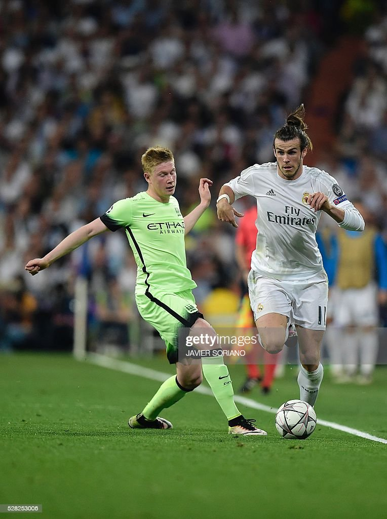 Manchester City's Belgian midfielder Kevin De Bruyne (L) vies with Real Madrid's Welsh forward Gareth Bale during the UEFA Champions League semi-final second leg football match Real Madrid CF vs Manchester City FC at the Santiago Bernabeu stadium in Madrid, on May 4, 2016. / AFP / JAVIER