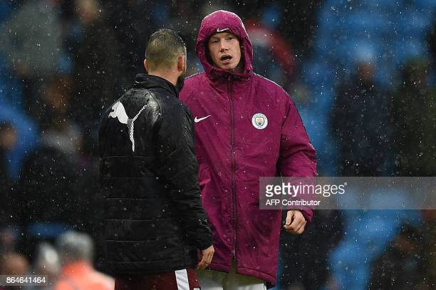 Manchester City's Belgian midfielder Kevin De Bruyne walks in the rain following the English Premier League football match between Manchester City...