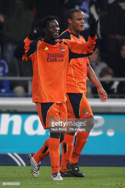 Manchester City's Benjani Mwaruwari celebrates scoring his sides first goal of the game with teammate Vincent Kompany