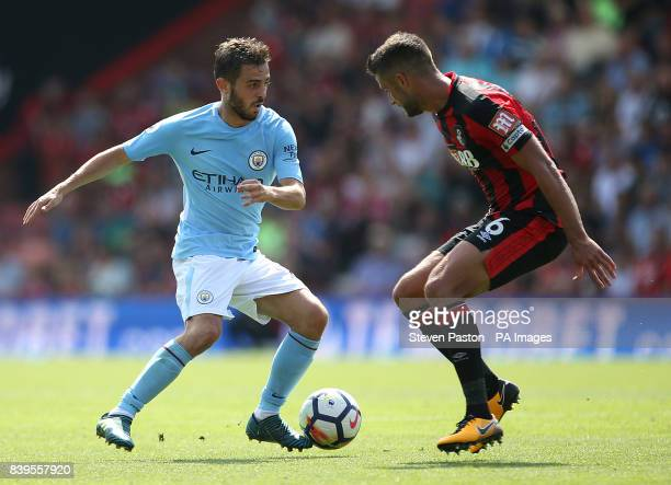 Manchester City's Bernado Silva and AFC Bournemouth's Andrew Surman during the Premier League match at the Vitality Stadium Bournemouth