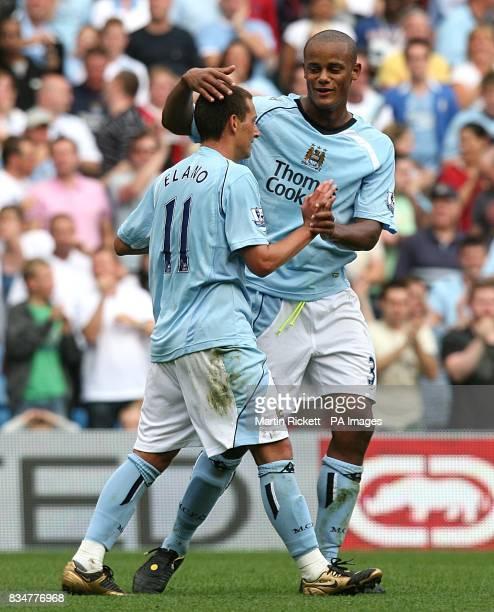 Manchester City's Blumer Elano celebrates scoring his secong goal with team mate Vincent Kompany