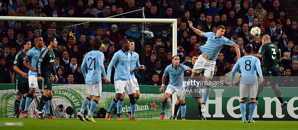 Manchester City's Bosnian forward Edin Dzeko (2L) jumps to block a header from Real Madrid's Portuguese defender Pepe (R) during the UEFA Champions League Group D football match between Manchester City and Real Madrid at The Etihad Stadium in Manchester, north-west England, on November 21, 2012.
