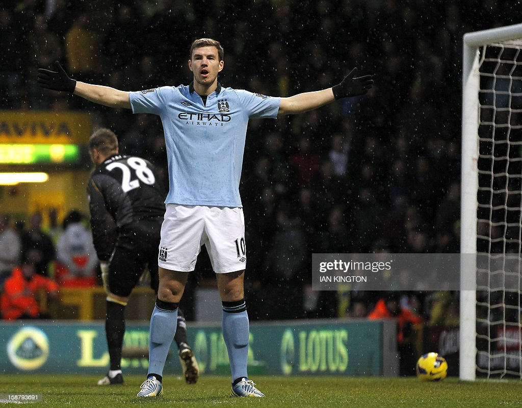 """Manchester City's Bosnian striker Edin Dzeko celebrates scoring the opening goal of the English Premier League football match between Norwich City and Manchester City at Carrow Road stadium in Norwich, England on December 29, 2012. USE. No use with unauthorized audio, video, data, fixture lists, club/league logos or """"live"""" services. Online in-match use limited to 45 images, no video emulation. No use in betting, games or single club/league/player publications."""