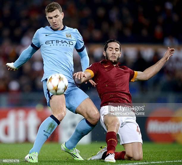 Manchester City's Bosnian striker Edin Dzeko vies with Roma's defender from Greece Konstantinos Manolas during the UEFA Champions League football...