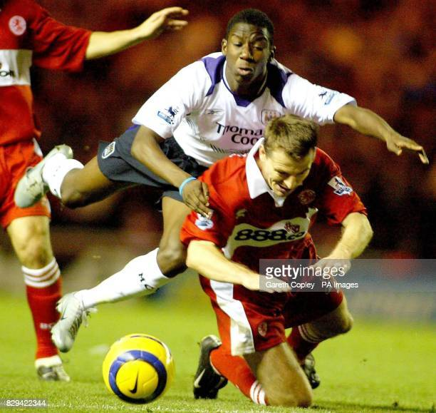 Manchester City's Bradley Wright Phillips falls under the challenge from Middlesbrough's Colin Cooper during the Barclays Premiership match between...