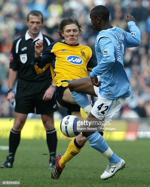 Manchester City's Bradley WrightPhillips is challenged by Wigan Athletic's Jimmy Bullard as referee Martin Atkinson looks on