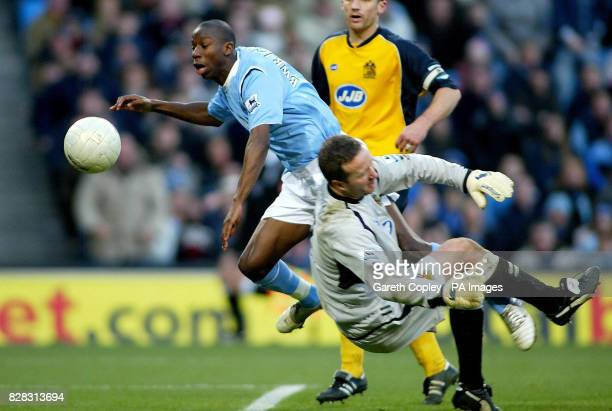 Manchester City's Bradley WrightPhillips is stopped by Wigan goalkeeper John Filan during the FA Cup fourth round match at the City of Manchester...