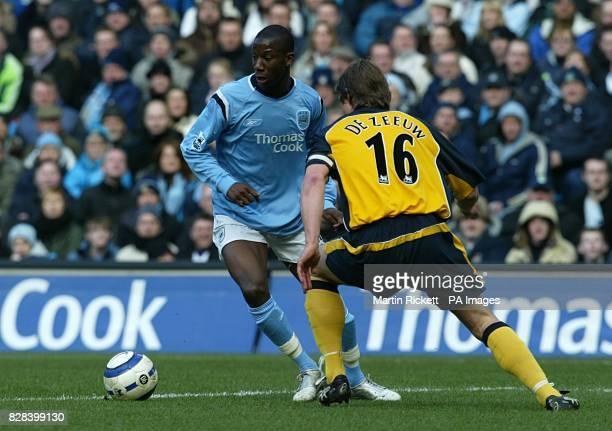 Manchester City's Bradley WrightPhillips takes on Wigan Athletic's Arjan De Zeeuw