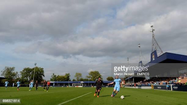 Manchester City's Brandon Barker battles for the ball against AS Roma's Daniele Verde
