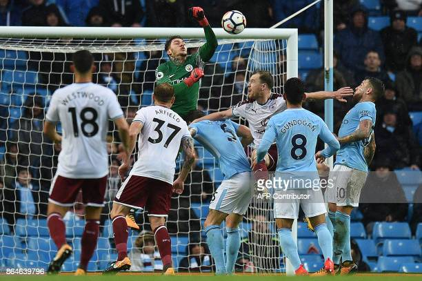 Manchester City's Brazilian goalkeeper Ederson jumps to clear the ball during the English Premier League football match between Manchester City and...