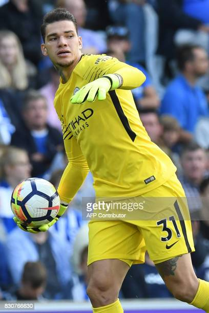 Manchester City's Brazilian goalkeeper Ederson throws the ball out during the English Premier League football match between Brighton and Hove Albion...