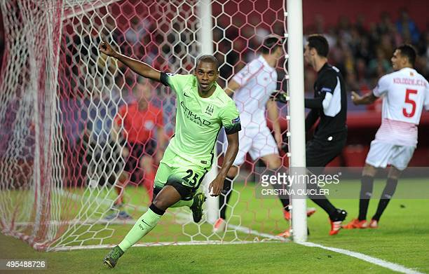 Manchester City's Brazilian midfielder Fernandinho celebrates after scoring during the UEFA Champions League football match Sevilla FC vs Manchester...