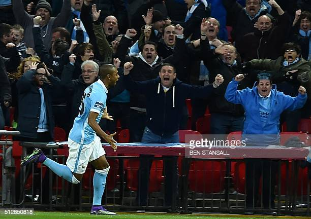 Manchester City's Brazilian midfielder Fernandinho celebrates after scoring the opening goal of during the English League Cup final football match...