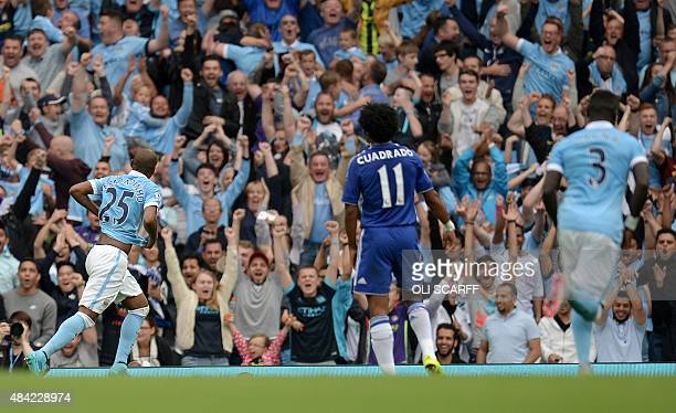 Manchester City's Brazilian midfielder Fernandinho celebrates scoring their third goal during the English Premier League football match between...