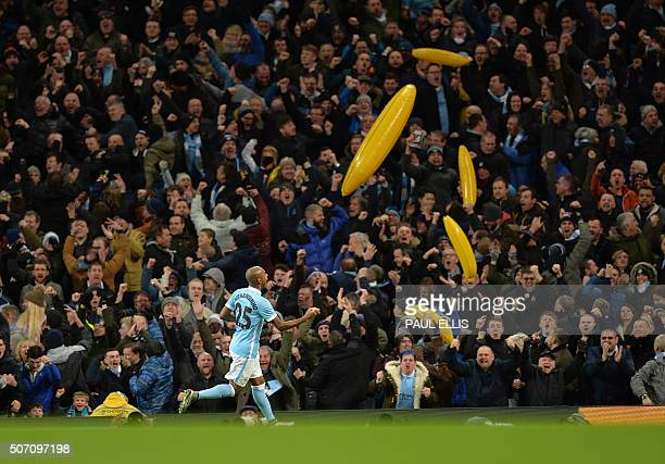 Manchester City's Brazilian midfielder Fernandinho celebrates scoring his team's first goal during the English League Cup semifinal second leg...