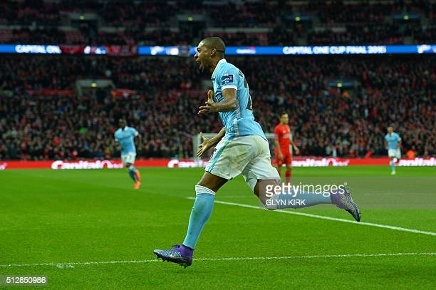 Manchester City's Brazilian midfielder Fernandinho celebrates scoring the opening goal of the English League Cup final football match between...