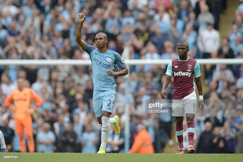 Manchester City's Brazilian midfielder Fernandinho celebrates scoring their second goal during the English Premier League football match between...