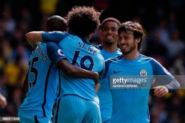 Manchester City's Brazilian midfielder Fernandinho celebrates scoring his team's fourth goal with Manchester City's German midfielder Leroy Sane...