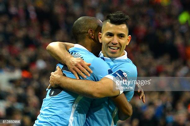 Manchester City's Brazilian midfielder Fernandinho celebrates with Manchester City's Argentinian striker Sergio Aguero after scoring the opening goal...