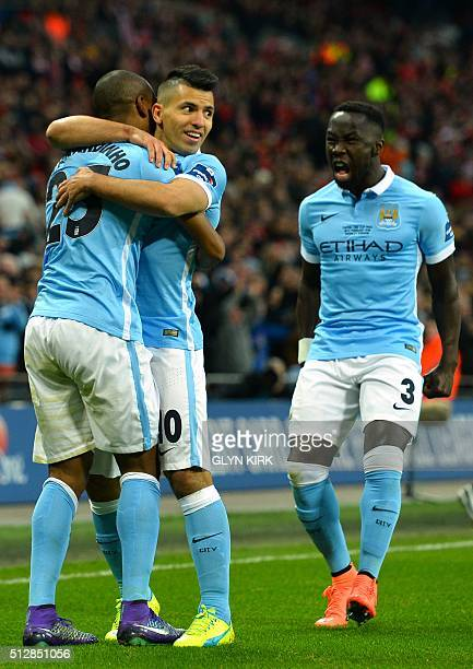 Manchester City's Brazilian midfielder Fernandinho celebrates with Manchester City's Argentinian striker Sergio Aguero and Manchester City's French...