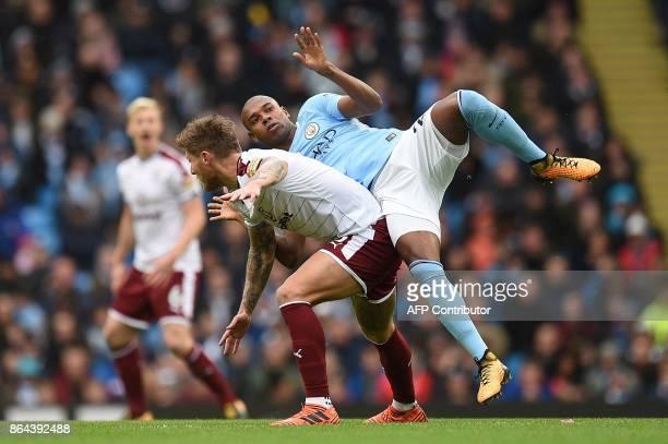Manchester City's Brazilian midfielder Fernandinho challenges Burnley's Irish midfielder Jeff Hendrick during the English Premier League football...
