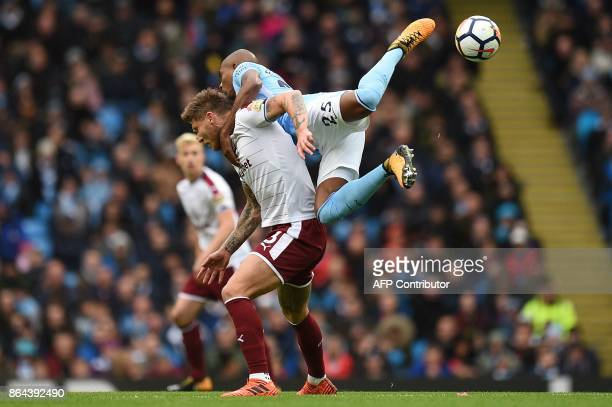 TOPSHOT Manchester City's Brazilian midfielder Fernandinho challenges Burnley's Irish midfielder Jeff Hendrick during the English Premier League...