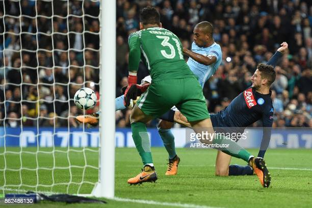 Manchester City's Brazilian midfielder Fernandinho clears the rebounding ball after Manchester City's Brazilian goalkeeper Ederson saved a penalty...